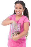 Little girl taking a cookie from jar Royalty Free Stock Photo