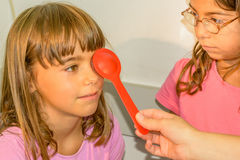 Little girl is taking the eye exam test Royalty Free Stock Images