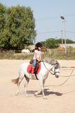 Little Girl Taking Horseback Riding Lessons Royalty Free Stock Image