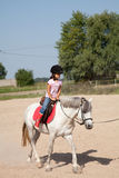 Little Girl Taking Horseback Riding Lessons Royalty Free Stock Photo