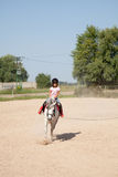 Little Girl Taking Horseback Riding Lessons Royalty Free Stock Photography