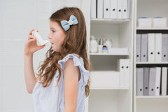 Little girl taking inhaler Royalty Free Stock Photography