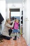 Little Girl taking jacket on stock photography