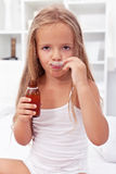 Little girl taking medication Stock Images