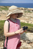 Little girl taking a photo Stock Image