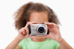 Little girl taking a picture stock photos