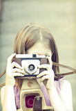 Little girl taking picture Stock Images
