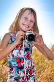 Little girl taking picture with SLR camera Royalty Free Stock Photography