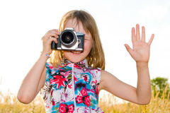 Little girl taking picture with SLR camera Royalty Free Stock Photo