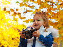 Little girl taking picture using vintage film camera Stock Photography
