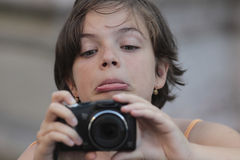 Little girl taking pictures Stock Photography