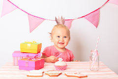 Little girl taking presents at first birthday Stock Photo