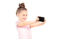 Little girl taking a selfie Royalty Free Stock Photo