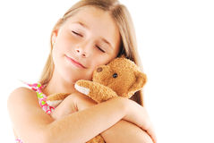 Little girl taking teddy bear. On white background Royalty Free Stock Photography