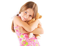 Little girl taking teddy bear. On white background Royalty Free Stock Image