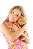 Little girl taking teddy bear. On white background Royalty Free Stock Images