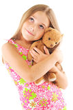 Little girl taking teddy bear. On white background Royalty Free Stock Photo