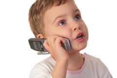 Little girl talk on the cell phone Stock Images