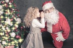 Little girl talk to Santa Claus wishlist, gifts, Christmas night Royalty Free Stock Image