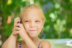 Little girl talking on cell phone Stock Images