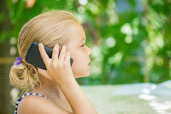Little girl talking on cell phone Royalty Free Stock Photo