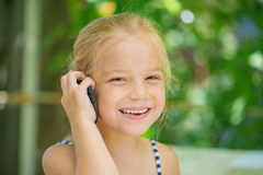 Little girl talking on cell phone Stock Photo