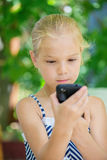 Little girl talking on cell phone Stock Photography