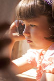 Little girl talking on cell phone Stock Photo