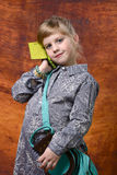 Little girl is talking on cell phone Royalty Free Stock Photography