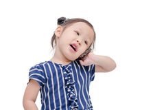 Little girl talking on cellphone. Little asian girl talking on cellphone isolated over white Stock Photos