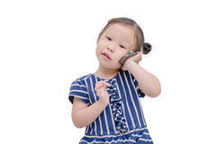 Little girl talking on cellphone. Little asian girl talking on cellphone isolated over white Royalty Free Stock Photos