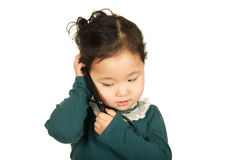 Little girl talking on the cellphone. Isolated on white background. Close-up Stock Images