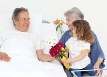 A little girl talking  with her grandparents Stock Photo