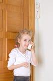 Little girl talking on the intercom Royalty Free Stock Image