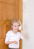Little girl talking on the intercom Stock Photo
