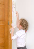 Little girl talking on the intercom Royalty Free Stock Photography