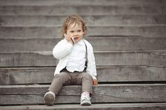 Little girl talking on mobile phone Royalty Free Stock Images