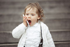 Little girl talking on mobile phone Stock Images