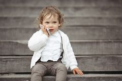 Little girl talking on mobile phone Stock Photography