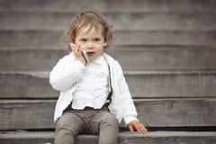 Little girl talking on mobile phone Stock Photography