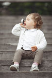 Little girl talking on mobile phone Stock Photos