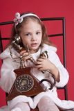 Little girl talking by old phone Royalty Free Stock Photography