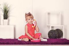 Little girl talking on the phone Stock Photos