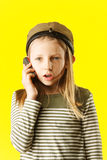 Little girl talking by phone Royalty Free Stock Photography