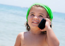 Little girl talking on phone Royalty Free Stock Photos