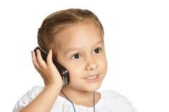 Little girl talking. On phone isolated on white background stock photo