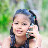 Little girl talking on the phone. Little girl talking on the phone,looking at camera royalty free stock photos