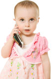 Little girl talking on the phone in a pink dress Royalty Free Stock Images