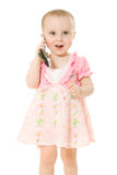 Little girl talking on the phone in a pink dress Stock Image