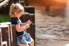 Little girl talking on a toy mobile phone royalty free stock image